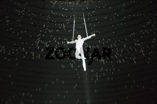 Belarus, Gomil, February 16, 2019. State Circus. Program Bravo Bravissimo. Aerial acrobat performs a circus trick. Gymnast under the circus dome