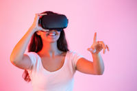Brunette with headset pointing her finger in virtual reality