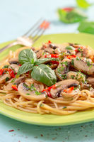 Pasta with mushrooms, sun-dried tomatoes and parsley.