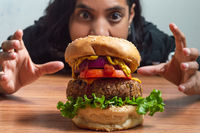 Pretty Mexican girl and vegetarian lentil burger