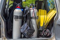 Diving equipment loaded in car trunk