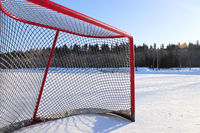 Side view of a hockey net on a skating pond