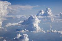 Blue sky landscape with big cumulus clouds.