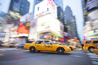Panning image of a Yellow Taxi cab in Times Square, New York City. New York. USA