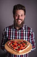 Man holding heart pizza