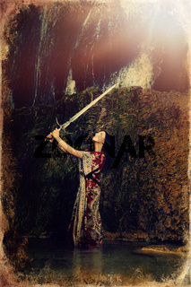 Woman with sword in lake near waterfall, old photo effect.