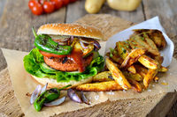 Vegan burger with potato wedges