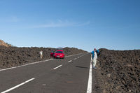 Tourists on the highway in Teide National Park, Tenerife, Canary Islands, Spain, Europe