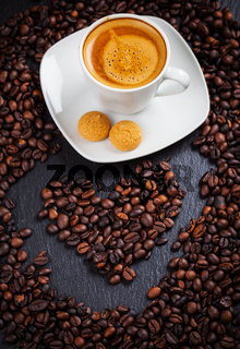 Espresso cup with heart of coffee beans