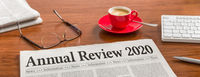 A newspaper on a wooden desk - Annual review 2020