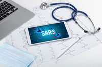 Tablet pc and doctor tools on white surface