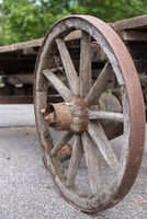 Weathered old wooden wagon wheel - cart