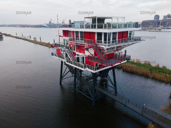 Amsterdam Houthaven, North-Holland, The Netherlands - 12-19-2020 Rem Eiland Amsterdam Restaurant old broadcast station from the north sea turned into cafe on the river Ij