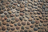 grunge old stone cobbles as a background