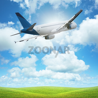Jet plane over the field of green