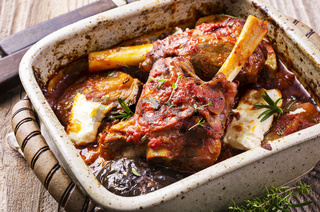 braised lamb knuckles with feta and aubergine