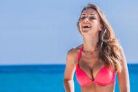 Woman in bikini laugh on beach