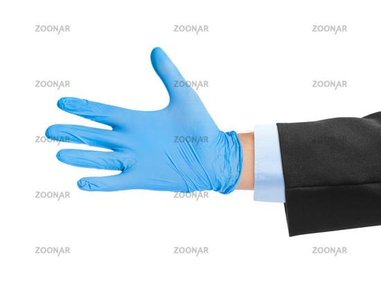Hand in blue medical glove