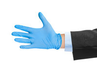 Hand in blue medical glove