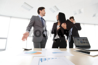 Business people discuss reports