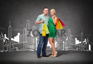 smiling couple with shopping bags