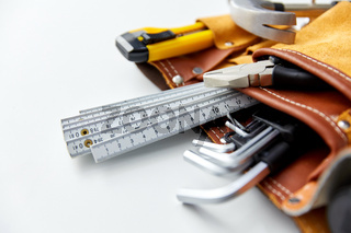 different work tools in belt on white background