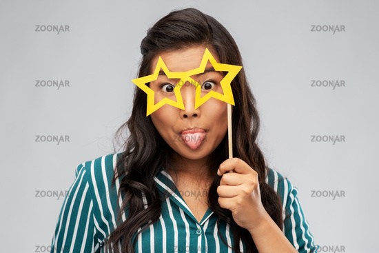 happy asian woman with star-shaped party glasses