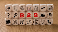 Dice with icons and the word B2B
