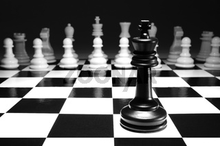 chess black king single alone against white army concept strategy game one selective focus