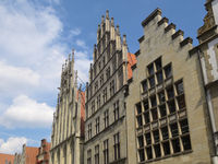 Münster - Row of houses with the Historical Town Hall at Prinzipalmarkt, Germany