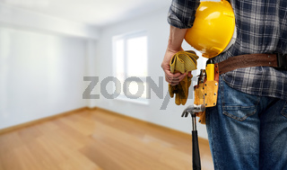 worker or builder with helmet and working tools