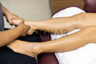 New Normal Asian woman with face mask do massage at home close up.