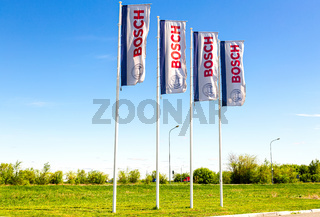Dealership flags of Bosch company against the blue sky