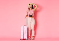 Tourism, summer vacation, holidays abroad concept. Full length of dreamy and amused asian girl traveller, tourist looking with amazement sideways, holding camera, want make pictures from journey