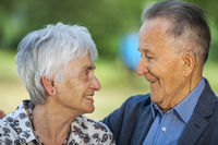 Pensioners in love smile happily at each other