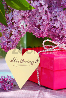 Purple lilac bouquet and mother's day card.