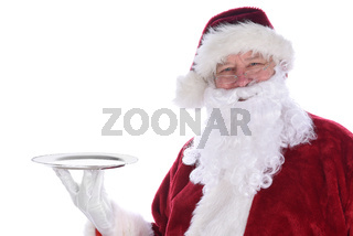 Santa Claus holding an empty silver platter isolated on white.