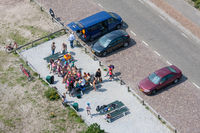 Aerial view at a car park with picnicking people