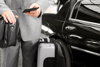 Traveling businessman calling by phone