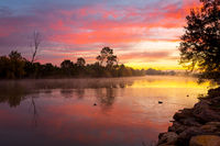 Beautiful sunrise over the billabong with a light ground fog