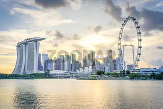 Singapore flyer and modern downtown skylines at sunset