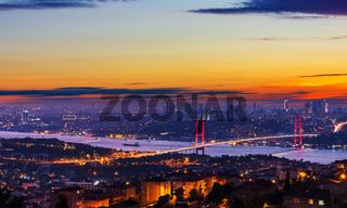 Sunset and illumination of the Bosphorus bridge and buildings of Istanbul, Turkey