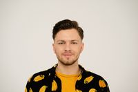 Close up portrait of handsome man in banana shirt looking at camera isolated on white background