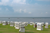 Beach of city Buesum with beach chairs, Schleswig-Holstein, Germany