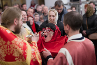 Belarus, Gomel, 8 April 2018. The Nikolsky Monastery. The celebration of Orthodox Easter. The ceremony of participle in the Orthodox faith. Communion Church
