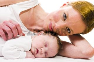 Newborn baby sleeping with mother