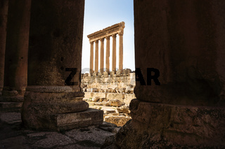 The columns of the Jupiter Tempel of Baalbek seen through columns, Lebanon