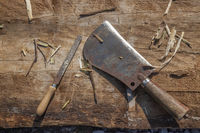 Hatchet and Rasp on Wooden Desk horizontal