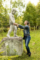 funny posing of a girl with a sculpture, entertainment