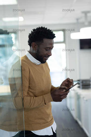 Businessman using smartphone at modern office